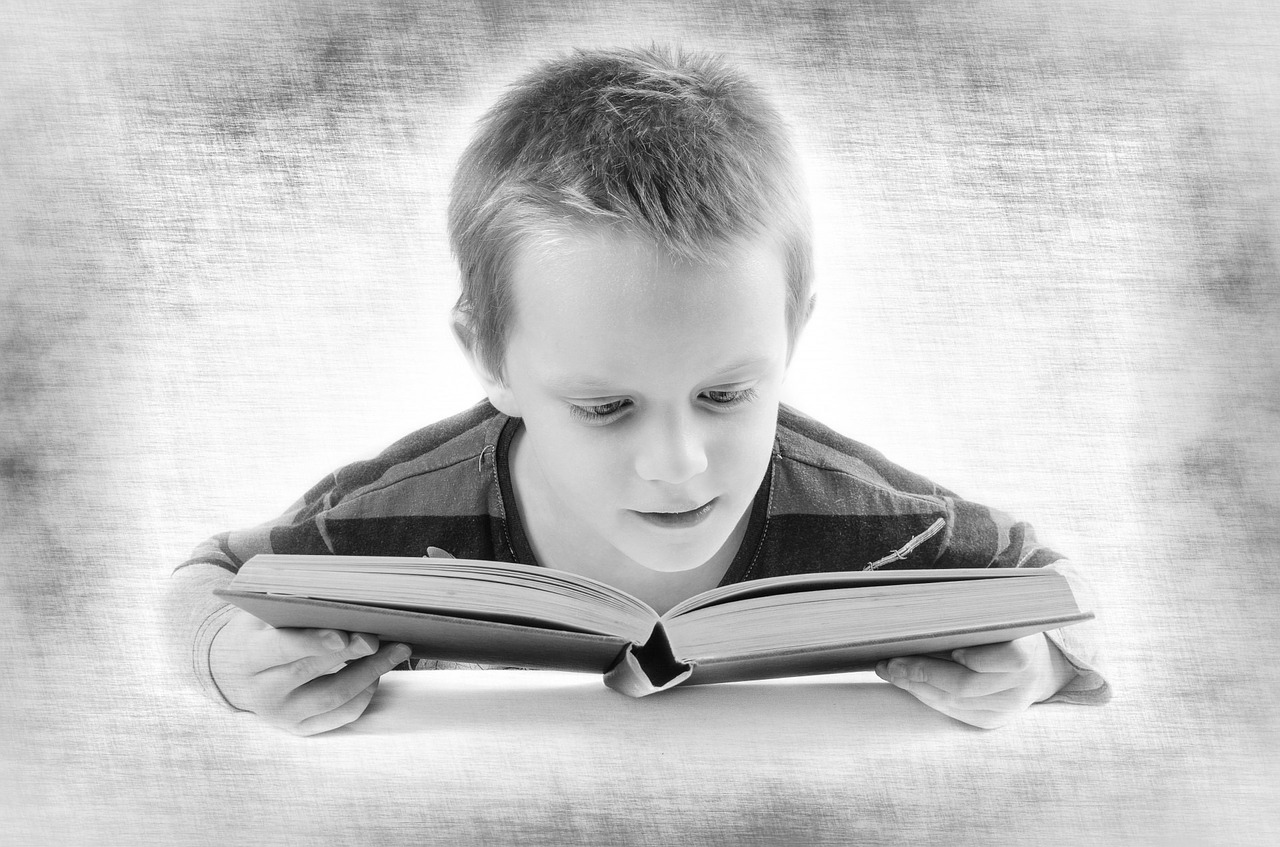 Partially sighted child reading